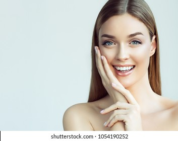 Happy beautiful girl is holding her cheeks with a laugh   looking  stright . Expressive facial expressions  .Cosmetology and Spa , skin care model