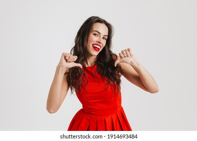 Happy beautiful girl smiling and pointing fingers at herself isolated over pink background