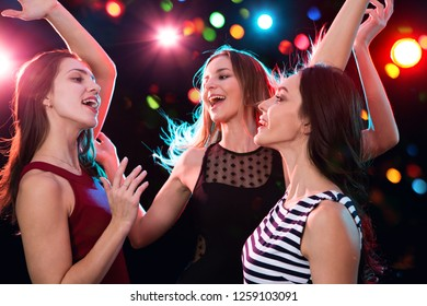 Happy beautiful girls have fun at a Christmas party