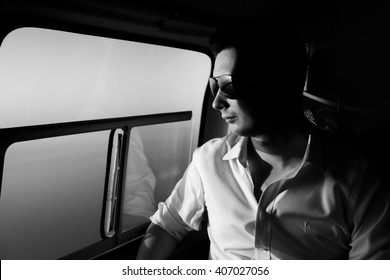 Happy beautiful groom in the helicopter b&w