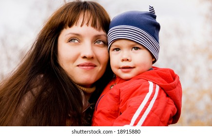 happy beautiful mother and her son outdoor