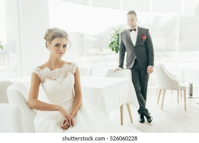 Happy beautiful newlyweds in restaurant