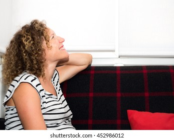 Happy and beautiful pregnant woman at home expecting her next baby