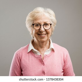 Happy beautiful senior lady posing and smiling, she is looking at camera