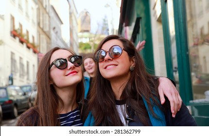 Happy beautiful student girls in Paris on the street