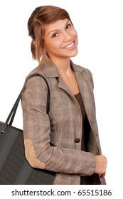 Happy beautiful teenage girl holding a shopping bag isolated on white background