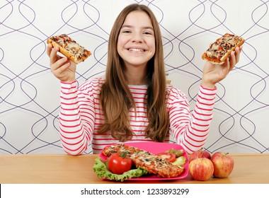 Happy beautiful teenage girl with sandwiches