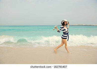 Happy Beautiful Woman Enjoying Summer Vacation on beach