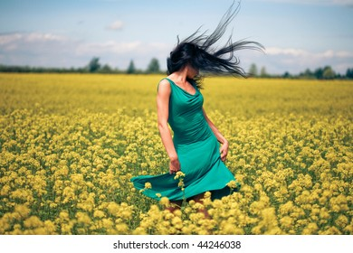 Happy beautiful woman in the field
