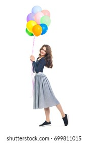 Happy beautiful woman holding colorful balloons isolated on white background. Full length portrait