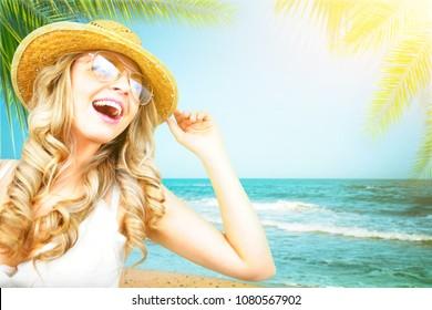 Happy beautiful woman on the beach