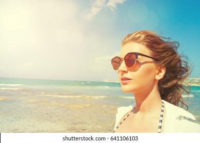 Happy beautiful woman on the beach.