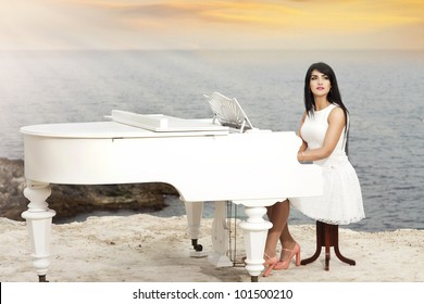 happy beautiful woman resting near sea with grand piano smiling with healthy glossy hair. Rich lady relaxing at beach spring-summer - vacation
