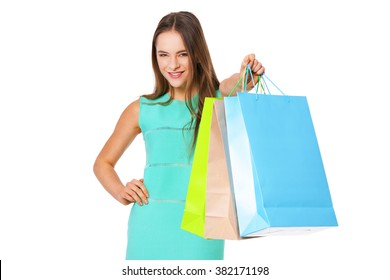 Happy beautiful woman with shopping bags isolated on white background. Shopping concept.