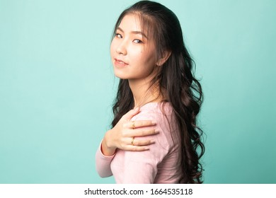 Happy Beautiful young Asian woman on cyan background