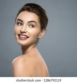Happy  beautiful young brunette woman with clean face. Beautiful face of  a smiling  caucasian model with clean fresh skin.