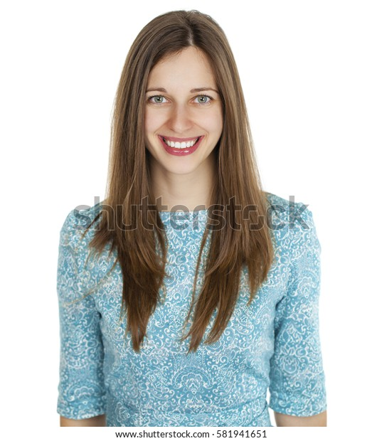 Happy beautiful young brunette woman in a turquoise dress on white background. Studio portrait