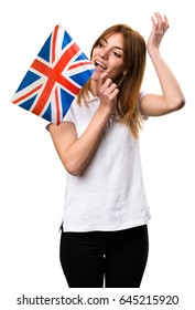 Happy Beautiful young girl holding an United Kingdom flag