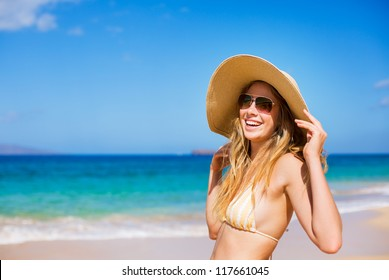 Happy Beautiful Young Woman at the Beach in Bikini