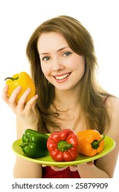 happy beautiful young woman with colorful peppers