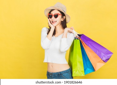 Happy Beautiful young woman with shopping bags