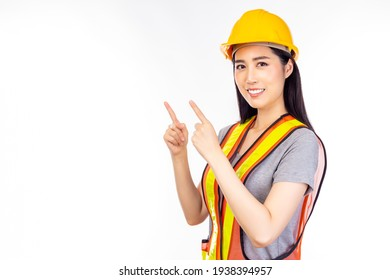 Happy beautiful young worker woman with isolated on white background pointing finger up to copy space for insert advertisement Happiness and smiley face Attractive beautiful engineer female portrait