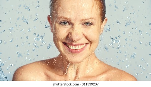 Happy beauty woman skin care, washing with splashes and drops of water