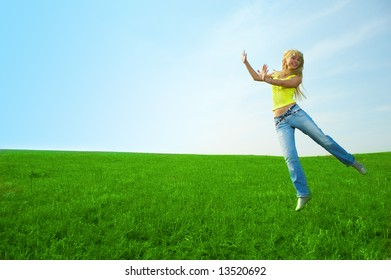 happy beauty young woman jump in field with green grass