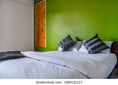 Happy bedroom and comfortable mattress and pillows over light at window, Room and interior concept