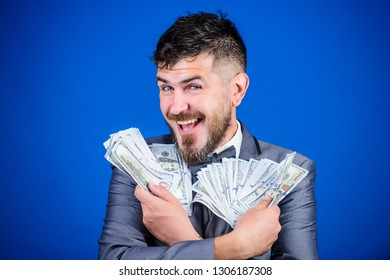 Happy being rich. Rich businessman with us dollars banknotes. Currency broker with bundle of money. Bearded man holding cash money. Making money with his own business. Business startup loan.