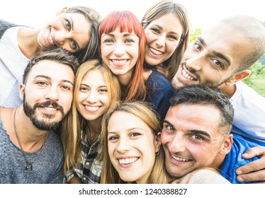 Happy best friends taking selfie outdoors with desaturated backlighting - Youth and friendship concept with young people having fun together - Bright vintage filter with soft sunshine color tones