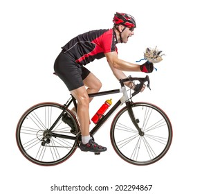 Happy bicyclist riding a bicycle isolated on white background. The winning cyclist with a flower. Winner of the cycling race on road bikes. Cyclist rides with a flower in his hand.