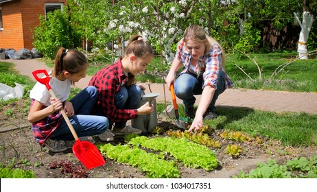 Happy big family working in garden at sunny day