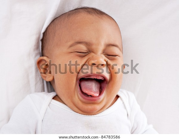 happy big laughing 7-month old African American baby boy