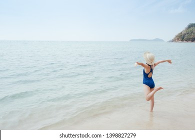 Happy bikini Woman on the beach and clouds  sky.Summer holiday concept.
