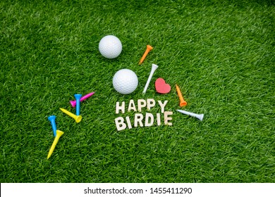 Happy birdie to golfer with golf ball on green grass