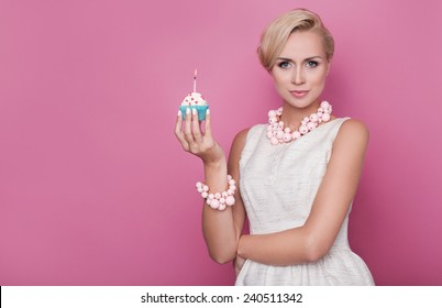 happy birthday beautiful young women holding small cake with colorful candle studio portrait over