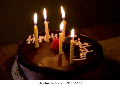 Happy Birthday Cake with Burning Candles
