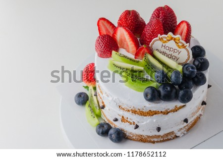 Happy Birthday CakeFresh Fruit Strawberry Blueberry And Kiwi Homemade Cake