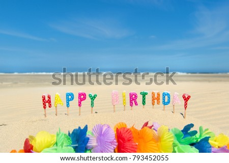 Happy Birthday Candles And Flower Garland At The Beach