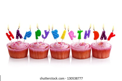 Happy birthday candles on pink cupcakes isolated on white