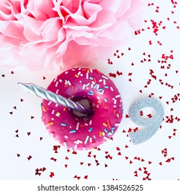 """Happy birthday card for a girl - a donut in pink icing, the number """"nine"""" and a silver candle. Happy Birthday background with pink donut. Happy birthday - nine years old princess. Girl's ninth birthda"""