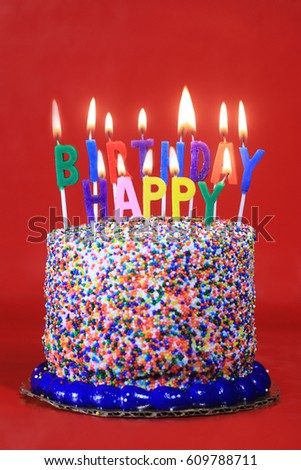 Happy Birthday Celebration Candles On Cake Red Background