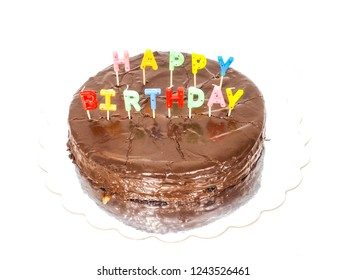 Happy birthday, chocolate cake with letter candles isolated on white