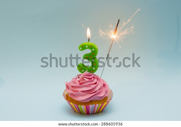 Happy Birthday Cupcake with Number three candle and sparkler