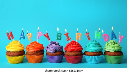 Happy birthday cupcakes on blue background