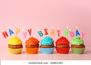 Happy birthday cupcakes on pink background