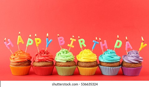 Happy birthday cupcakes on red background