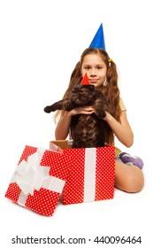 Happy birthday girl holding furry present
