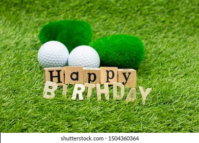 Happy Birthday to golfer with golf ball and sign on green grass.